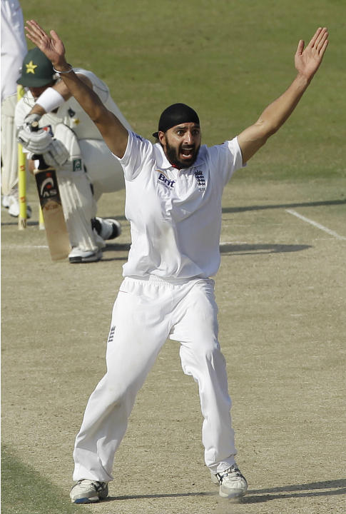 England's Monty Panesar, right, celebrates taking the wicket of Pakistan's Misbah-ul-Haq, rear, lbw during the third day of the second cricket test match of a three match series between England and Pa