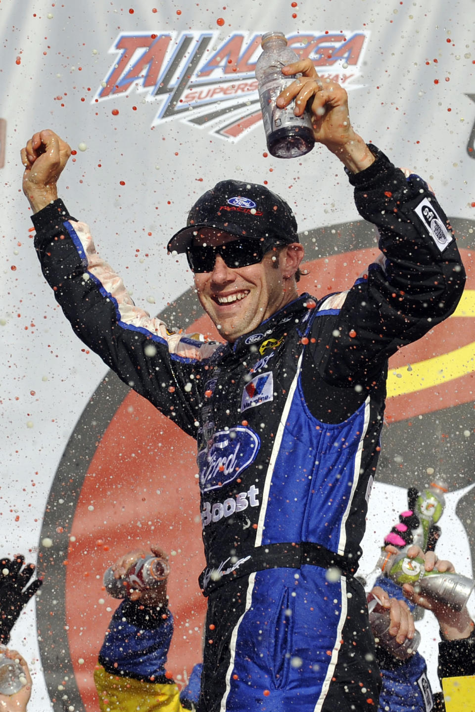 Matt Kenseth celebrates in Victory Lane after winning the NASCAR Sprint Cup Series auto race at Talladega Superspeedway in Talladega, Ala., Sunday, Oct. 7, 2012. (AP Photo/Rainier Ehrhardt)