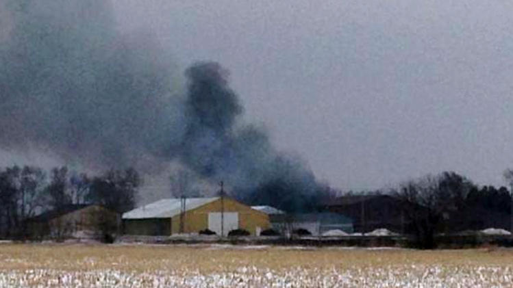 In this image from video provided by KIMT-TV smoke rises from a fire in Northwood, Iowa, Thursday, Feb. 20, 2014. Authorities say an evacuation order is in place for Northwood due to a fire at a fertilizer plant at Northwood Municipal Airport. No one is reported injured. (AP Photo/KIMT-TV, Levi Ismail)