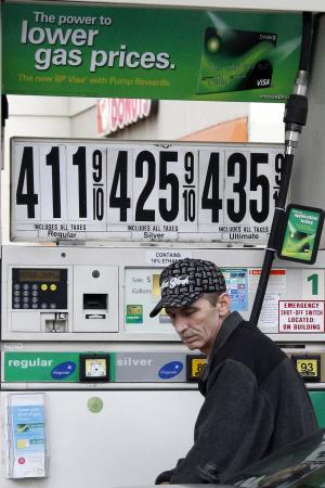 In this March 2, 2012 photo, Al Milani of Staten Island, pumps gas in Manhattan at a BP mini-mart. The price at the gas pump rose over the weekend and the nationwide average is nearing $3.80 a gallon. Oil is close to $107 per barrel because of tensions tied to Iran's nuclear program. (AP Photo/Gene J. Puskar)