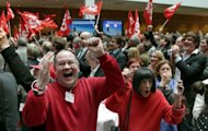Supporters of the German Social Democratic Party (SPD) celebrate taking 39% of the vote in the regional elections of North Rhine-Westphalia in Berlin, on May 13, 2012. Chancellor Angela Merkel&#39;s Christian Democrats its worst ever result in the state, with just over 26 percent, according to preliminary results