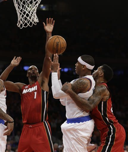 Heat rally past Knicks, win 14th straight