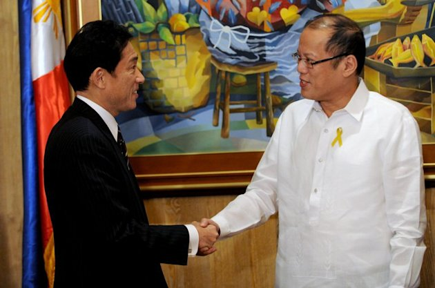 Philippine President Benigno Aquino (R) welcomes Japanese Foreign Minister Fumio Kishida at Malacanang Palace in Manila, on January 10, 2013. Japan plans to donate patrol boats costing $11 million each to the Philippines, ramping up regional efforts to monitor China's maritime activity in disputed waters, according to a newspaper