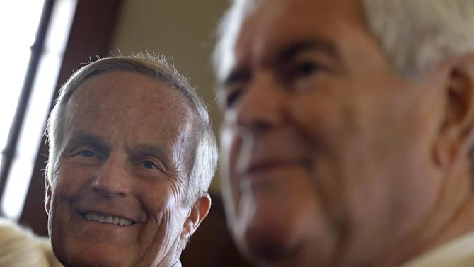 Missouri Republican Senate candidate, Rep. Todd Akin, R-Mo., smiles at left as former House Speaker Newt Gingrich speaks during news conference, Monday, Sept. 24, 2012, in Kirkwood, Mo. Akin is seeking to unseat incumbent Sen. Claire McCaskill, D-Mo. in the November election. (AP Photo/Jeff Roberson)