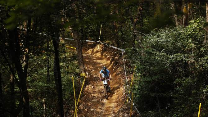 Mongolia's Enkhjargal Tuvshinjargal competes in the the women's cross-country mountain bike cycling competition at the Yeongjong Baegunsan Course during the 17th Asian Games in Incheon