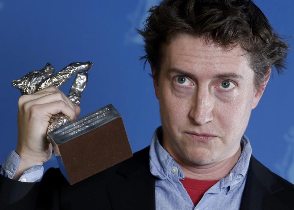 "Director David Gordon Green poses backstage with his Silver Bear award for Best Director for the movie ""Prince Avalanche"" during the awards ceremony at the 63rd Berlinale International Film Festival in Berlin Saturday, Feb. 16, 2013. (AP Photo/Thomas Peter, pool)"