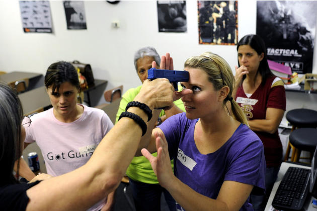 A group of local public school teachers from nearby schools use rubber training guns as they practice drills on disarming an attacker  during a teachers-only firearms training class offered for free a