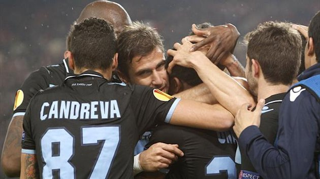 DATE IMPORTED:March 7, 2013Lazio players celebrate after scoring a goal during their Europa League match against VfB Stuttgart