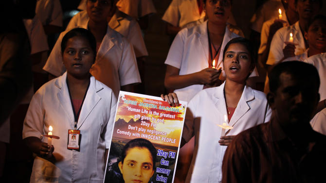 Students of a nursing college pray as they participate in a candle light vigil organized by a local politician in Bangalore, India, Thursday, Dec. 13, 2012, to condole the death of Jacintha Saldanha, a nurse at King Edward VII hospital in London, who killed herself after taking a hoax call from Australian DJs about the pregnant Duchess of Cambridge. (AP Photo/Aijaz Rahi)
