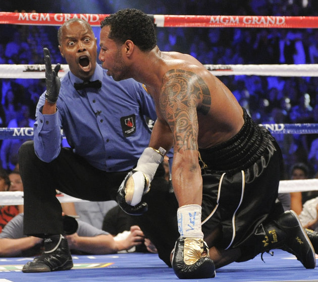 Referee Kenny Bayless, left, issues the count on Shane Mosley who was knocked down in the third round by Manny Pacquiao during a WBO welterweight title bout, Saturday, May 7, 2011, in Las Vegas.  (AP