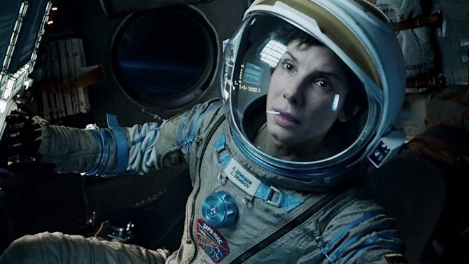 "This film image released by Warner Bros. Pictures shows Sandra Bullock in a scene from ""Gravity."" With the tightest three-way Oscar race in years, the 66th Directors Guild of America Awards could give ""Gravity,"" ""American Hustle"" or ""12 Years a Slave"" the edge in the home stretch to the Oscars. The DGA hands out awards for best director in TV and movie categories in Los Angeles on Saturday, Jan. 25, 2014 in what customarily is a final calling for the film that wins the picture and director Oscars. (AP Photo/Warner Bros. Pictures, File)"