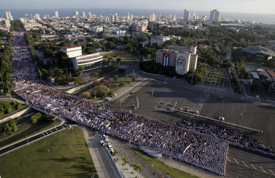 People gather for a May Day march in Revolution Square in Havana, Cuba, Tuesday, May 1, 2012. (AP Photo/Javier Galeano, Pool)
