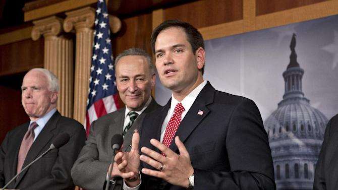 Sen. Marco Rubio, R-Fla., center, takes a reporter's question as a bipartisan group of leading senators announce that they have reached agreement on the principles of sweeping legislation to rewrite the nation's immigration laws, during a news conference at the Capitol in Washington, Monday, Jan. 28, 2013. From left are Sen. John McCain, R-Ariz., Sen. Charles Schumer, D-N.Y., and Sen. Marco Rubio, R-Fla. The deal covers border security, guest workers and employer verification, as well as a path to citizenship for the 11 million illegal immigrants already in this country.  (AP Photo/J. Scott Applewhite)