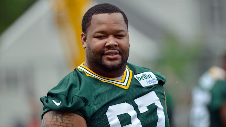 Jun 11, 2013; Green Bay, WI, USA; Green Bay Packers defensive tackle Johnny Jolly works out during organized team activities at Clarke Hinkle Field in Green Bay. (Benny Sieu-USA TODAY Sports)