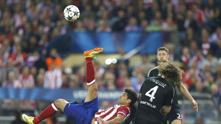 Atletico Madrid's Diego Costa fires an an overhead kick over Chelsea's David Luiz during their Champion's League semi-final first leg soccer match at Vicente Calderon stadium in Madrid