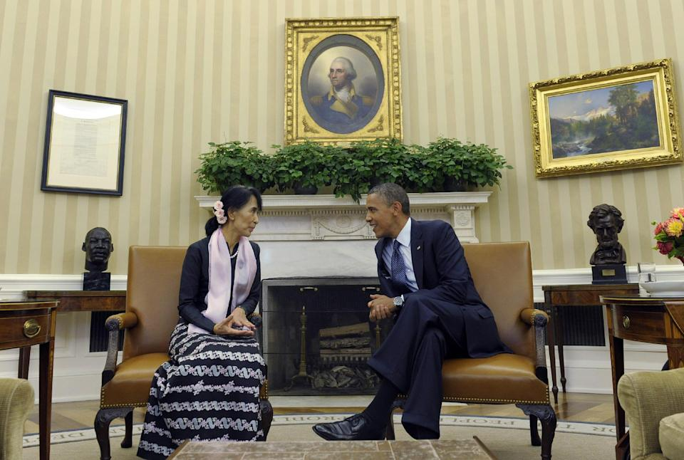 FILE - In this Wednesday, Sept. 19, 2012 file photo, President Barack Obama meets with Myanmar democracy leader Aung San Suu Kyi in the Oval Office of the White House in Washington. (AP Photo/Susan Walsh)
