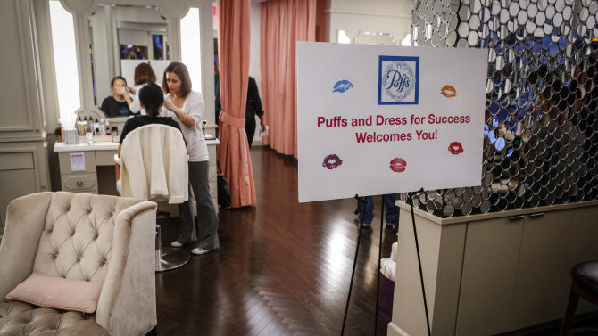 "A sign greets guests at the Puffs Tissues ""Kisses"" event on Tuesday, Feb. 5, 2013, at Blushington Salon in West Hollywood, Calif. (Bret Hartman/AP Images for Puffs)"