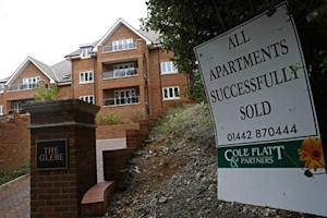 A sign is seen outside some newly built apartments in Berkhampstead, southern England
