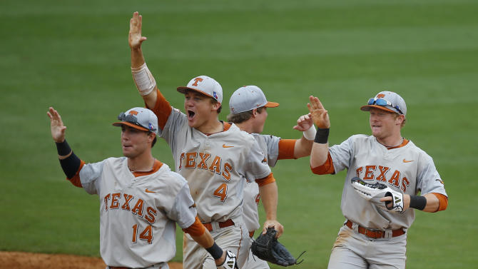 Texas' Ben Johnson (14), Collin Shaw (4) and Zane Gurwitz, right, celebrate after defeating Baylor in a semi-final game during the NCAA college Big 12 conference baseball tournament Saturday, May 23, 2015, in Tulsa, Okla. Texas won 4-0. (AP Photo/Sue Ogrocki)