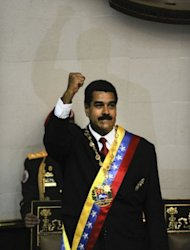 Venezuelan President Nicolas Maduro raises his clenched fist during his inauguration in Caracas on April 19, 2013