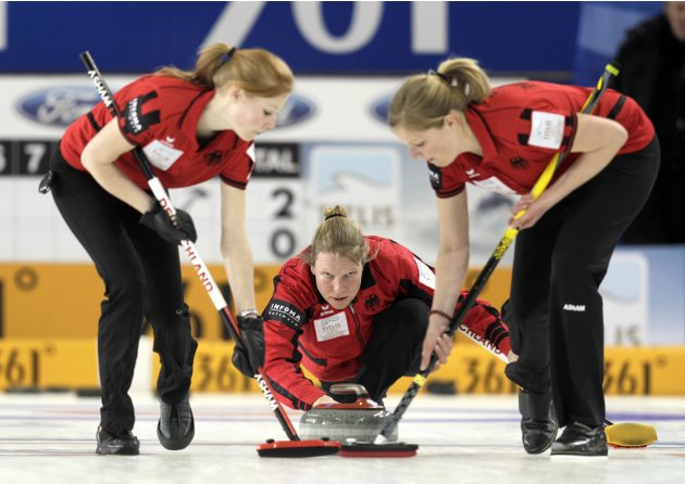 Germany's skip Schopp delivers a stone during their World Women's Curling Championship qualification round against Denmark in Riga