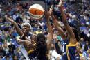 Minnesota Lynx center Sylvia Fowles (34) passes through Indiana Fever guard Shavonte Zellous (1) and Tamika Catchings (24) in the second half of Game 2 of the WNBA basketball finals, Tuesday, Oct. 6, 2015, in Minneapolis. (AP Photo/Jim Mone)