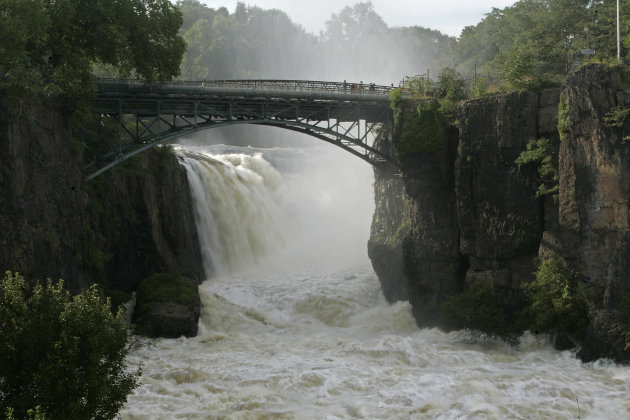 Water from the swollen Passaic River pours over the Great Falls in Paterson, N.J., Wednesday, Aug. 31, 2011. Three days after Hurricane Irene blasted through the state and up the East Coast, there was