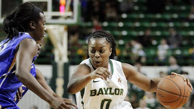 FILE - In this Dec. 21, 2011, file photo, Baylor guard Odyssey Sims (0) drives against McNeese State during an NCAA college basketball game in Waco, Texas. Sims received 19 votes from a national media panel Tuesday, Oct. 30, 2012, to join The Associated Press' women's basketball preseason All-America team. (AP Photo/Tony Gutierrez, File)