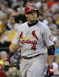 St. Louis Cardinals' Yadier Molina walks back to the dugout after striking out to end the fourth inning during a baseball game against the Pittsburgh Pirates in Pittsburgh Monday, July 29, 2013. (AP Photo/Gene J. Puskar)