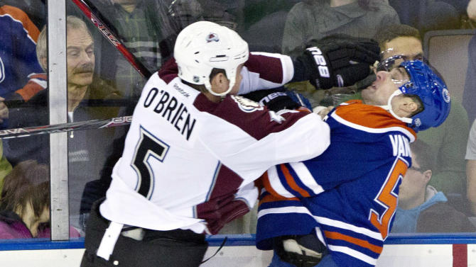 Colorado Avalanche's Shane O'Brien (5) checks Edmonton Oilers' Chris VandeVelde during the first period of an NHL hockey game in Edmonton, Alberta, on Saturday Feb. 16, 2013. (AP Photo/The Canadian Press, Jason Franson)