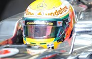 McLaren-Mercedes driver Lewis Hamilton of Britain leaves his pit during the second free practice session of the Formula One Japanese Grand Prix in the Suzuka circuit on October 5