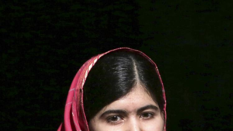 Pakistani schoolgirl activist Malala Yousafzai speaks at a youth symposium and cultural show in Port-of-Spain
