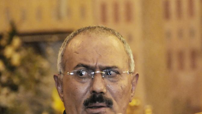 FILE - In this Saturday, Dec. 24, 2011 file photo, Yemen's President Ali Abdullah Saleh speaks to reporters during a press conference at the Presidential Palace in Sanaa, Yemen. According to a senior official  at the main air force base in Sanaa, Saleh's half brother Mohammed Saleh al-Ahmar, the air force commander, refused to send helicopters to evacuate wounded after an al-Qaida attack at an army camp in southern Yemen. . (AP Photo/Mohammed Hamoud, File)