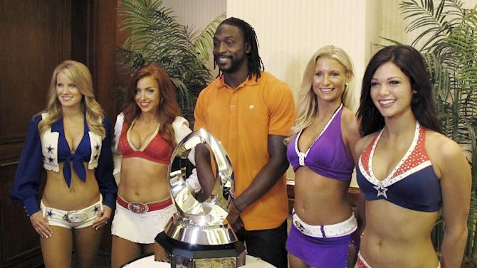 Chicago Bears cornerback Charles Tillman poses for photos with cheerleaders after a news conference to kick off NFL football Pro Bowl week in Honolulu, Tuesday, Jan. 22, 2013. The NFL is hoping to decide the fate of the Pro Bowl by the time it releases next season's schedule in April. And the fate of the league's all-star game will largely depend on how much effort this year's participants put into the game scheduled for Sunday at Aloha Stadium. (AP Photo/Oskar Garcia)