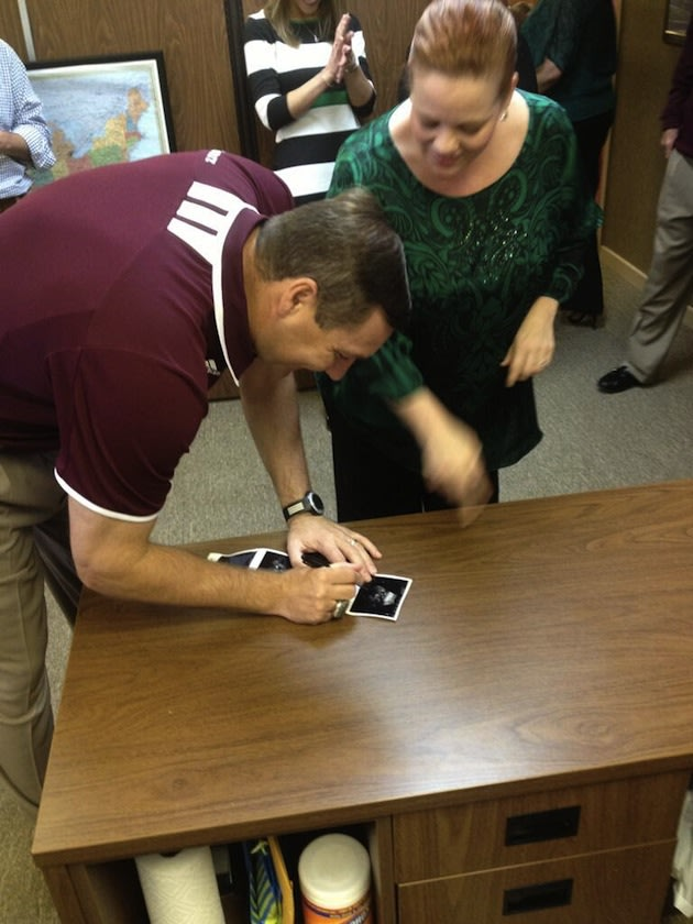 Dan Mullen signs a pregnant Mississippi State fan's ultrasound.