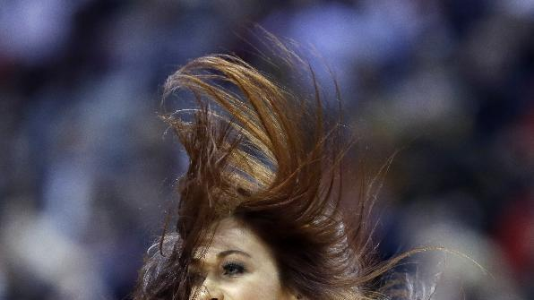 Hair flies as a Portland Trail Blazers dancer goes through a routine during the second half of an NBA basketball game against the Cleveland Cavaliers in Portland, Ore., Wednesday, Jan. 15, 2014.  Portland Won 108-96
