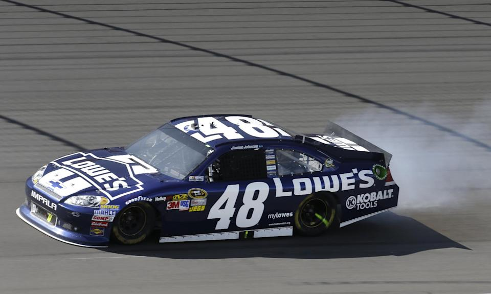 Jimmie Johnson pulls out of the racing line as his engine smokes in the NASCAR Sprint Cup Pure Michigan 400 auto race at Michigan International Speedway Sunday, Aug. 19, 2012, in Brooklyn, Mich.  (AP Photo/Paul Sancya)