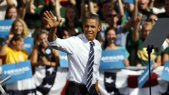 President Barack Obama waves as he takes the stage during campaign stop on the campus of Colorado State University in Fort Collins, Colo., on Tuesday, Aug. 28, 2012.  (AP Photo/David Zalubowski)