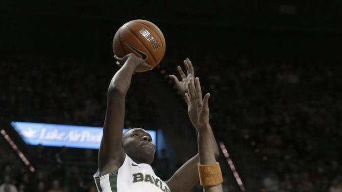 Baylor's Jordan Madden (3) shoots against Tennessee's Meighan Simmons (10) during the first half of an NCAA college basketball game Tuesday, Dec. 18, 2012, in Waco, Texas. (AP Photo/LM Otero)