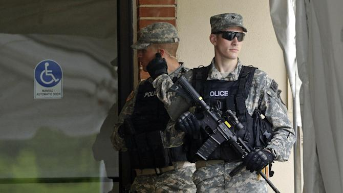 Military police stand guard outside of a courthouse in Fort Meade, Md., Monday, June 3, 2013, on the first day of Army Pfc. Bradley Manning's court martial. Manning, who was arrested three years ago, is charged with indirectly aiding the enemy by sending troves of classified material to WikiLeaks. He faces up to life in prison. (AP Photo/Patrick Semansky)