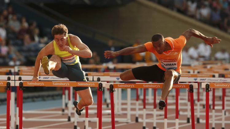 William Sharman of Britain and Sergey Shubenkov of Russia compete in the men's 110m hurdles during the IAAF Diamond League athletics meeting at Hampden Park in Glasgow