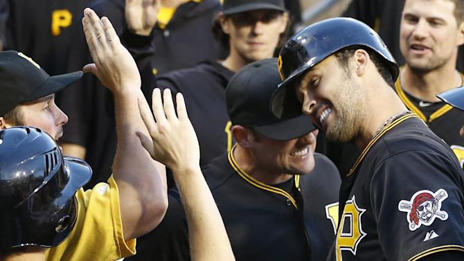 Pittsburgh Pirates' Garrett Jones, right, head-butts with teammate Michael McKenry (19) as he celebrates with teammates in the dugout after hitting a home run in the fourth inning of a baseball game against the Milwaukee Brewers on Saturday, June 29, 2013, in Pittsburgh. (AP Photo/Keith Srakocic)