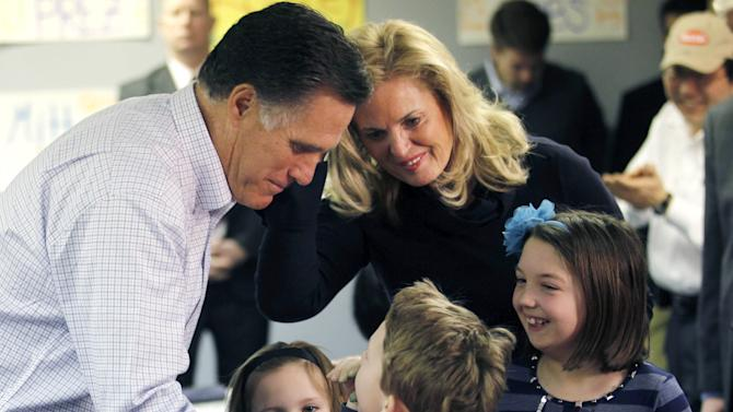 Republican presidential candidate, former Massachusetts Gov. Mitt Romney, and his wife Ann Romney, greet children of campaign volunteers as they visited a campaign call center in Livonia, Mich., Tuesday, Feb. 28, 2012. (AP Photo/Gerald Herbert)