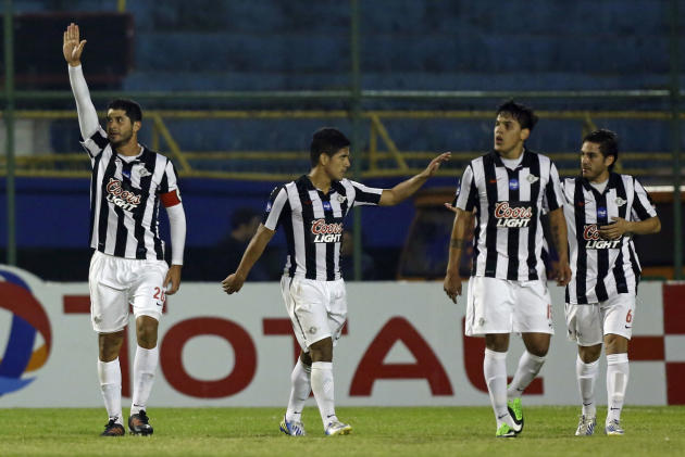 Pedro Benitez, left, of Paraguay's Libertad, celebrates his goal against Brazil's Sport Recife at a Copa Sudamericana soccer game in Asuncion, Paraguay, Wednesday, Sept. 25, 2013