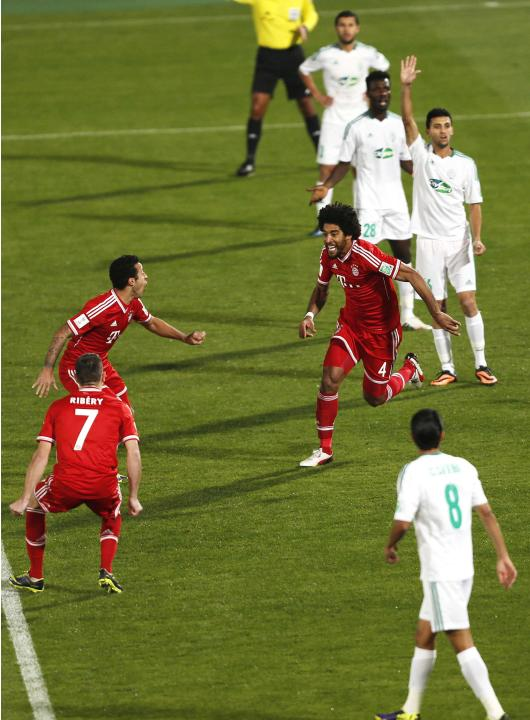 Dante of Germany's Bayern Munich runs as he celebrates his goal against Morocco's Raja Casablanca during their 2013 FIFA Club World Cup final soccer match at Marrakech stadium