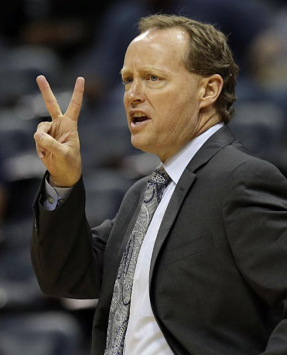 Atlanta Hawks head coach Mike Budenholzer signals to his players during in the first half of a preseason NBA basketball game against the Indiana Pacers Tuesday, Oct. 22, 2013, in Atlanta