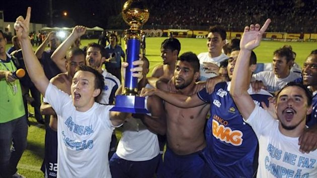 Cruzeiro's players celebrate with the trophy after winning the Brazilian Serie A championship title (Reuters)