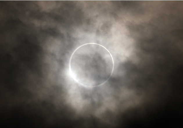 An annular solar eclipse is seen in the sky over Yokohama near Tokyo Monday, May 21, 2012.  The annular solar eclipse, in which the moon passes in front of the sun leaving only a golden ring around it