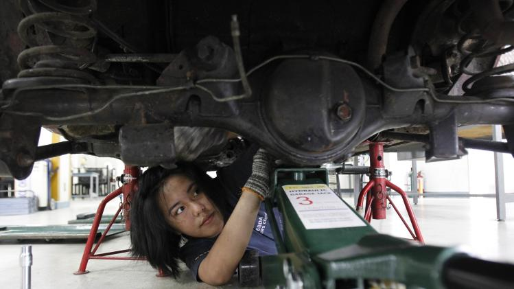 Vina Jane Aranas, 17, learns how to align the wheels of a car as part of her automotive training at the Technical Educational Skills and Development Authority (TESDA) in Taguig city, metro Manila