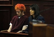 "James Holmes appears in court at the Arapahoe County Justice Center in Centennial, Colorado. Holmes, 24, is accused of shooting dead 12 people and wounding 58 others at a cinema Friday in Aurora, outside Denver, as young moviegoers packed the midnight screening of the latest Batman film, ""The Dark Knight Rises."""